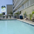 Pool image of Coastal Palms Inn & Suites