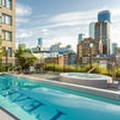 Swimming pool at Level Furnished Living Yaletown Seymour