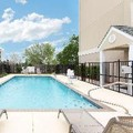 Swimming pool at Microtel Inn & Suites Baton Rouge by Wyndham Baton Rouge Airport