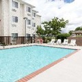 Swimming pool at Microtel Inn & Suites by Wyndham Starkville