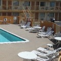 Swimming pool at Super 7 Inn Dallas Southwest