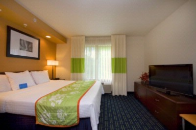 Enhance Your Stay With Our King Suite. A Half Wall Adds Privacy To The Sleeping Area With Is Own New Lcd Flat Panel Tv. 8 of 13