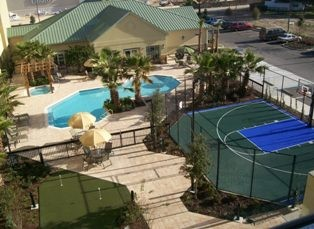 Enjoy Our Outdoor Courtyard With Pool Sports Court And Putting Green. 3 of 8