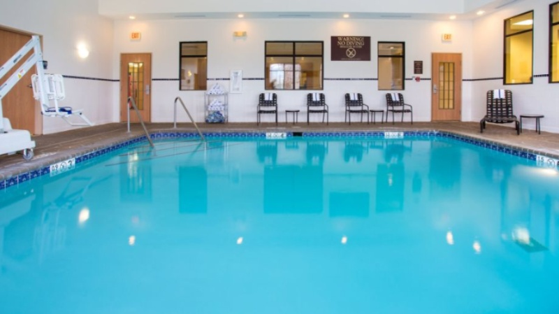 Our Indoor Heated Pool Has A Full Bathroom Attached To The Pool Deck. 8 of 10