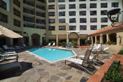 Relax Around The Pool And Enjoy A Freshing Beverage While Relaxing In The Courtyard. 3 of 8
