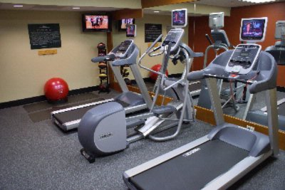 Our Fitness Center Will Assist You With Your Work Out Routine 8 of 14