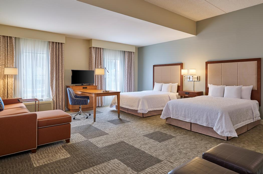 Our Double Queen Suite Offers Our Guests Two Queen Beds Sleeper Sofa And A Mini Microwave And Refrigerator In The Wet Bar Area. This Room Is A Great Choice For Larger Families Or Those Travelers That Want A Spacious Room To Stay In. 14 of 14
