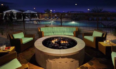 Dual Firepits Next To Salt Water Pool 24 of 26