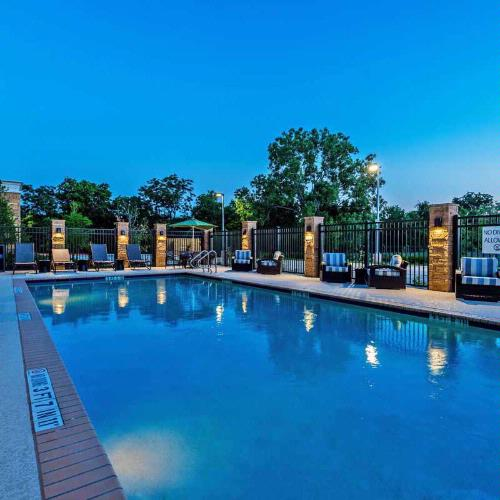 Take A Dip In Our Large Outdoor Pool. 26 of 27