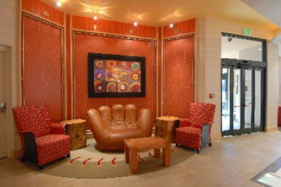 Relax In Our Intimate Sports-Themed Hotel Featuring Chain-Link Walls And Our Baseball-Mit Sofa! 2 of 10