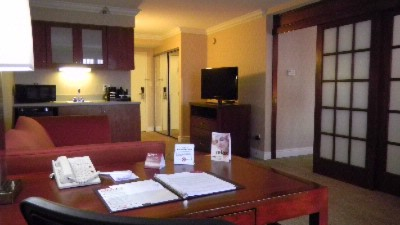 Sitting Area Of Suite The Bed Is Behind The Sliding Doors 10 of 24