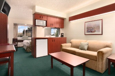 Microtel Suite With A Queen Bed Sofa Sleeper In Room Coffee Mini Fridge And Microwave. 5 of 6