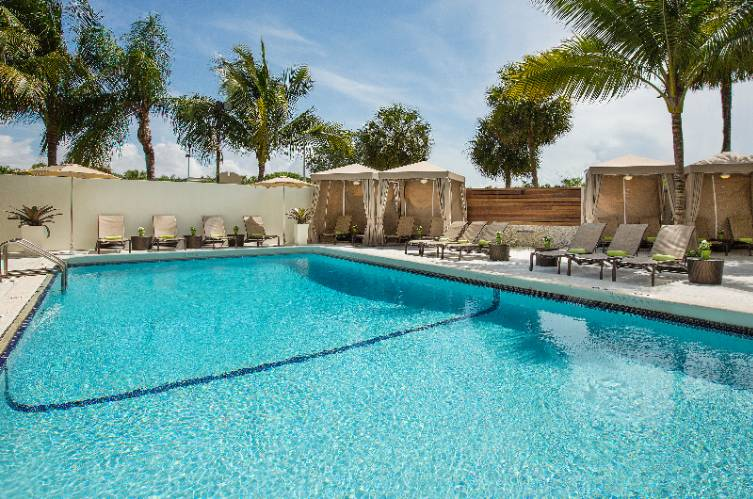 Unwind On Our Outdoor Pool And Cabanas 10 of 11