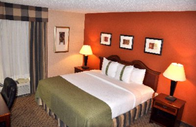 Our Spacious King Guest Room Features A Large Work Desk Connected To The Hotel\'s Complimentary High-Speed Internet Service. 6 of 16