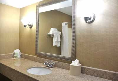 The Vanity In Our Guest Room Offers Plenty Of Space And Amenities To Get Ready For Your Big Day. 6 of 17
