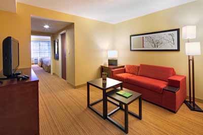 Our Spacious Suite Includes A Large Work Desk Lounge Area Wet Bar Area And Separate Room With Two Queen Beds. They Are Perfectly Designed For The Dynamic Business Traveler. 11 of 19
