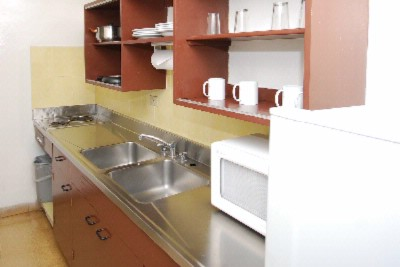 Suite Kitchens Have A Fridge Stove Microwave And Cooking Utencils 14 of 14