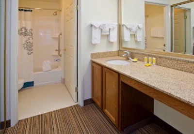 Each Guest Suite Features A Modern Bathroom With Granite Countertops Wood Furnishings And Davies Gate Quince Toiletries. 10 of 19