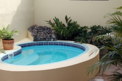 The Shared Jacuzzi Is In Our Back Patio Al Fresco. 3 of 16