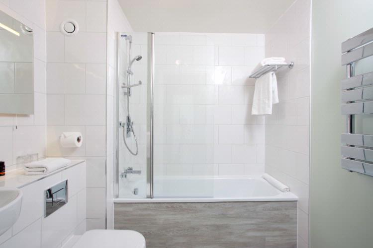 Standard Twin Bath With Shower 8 of 31