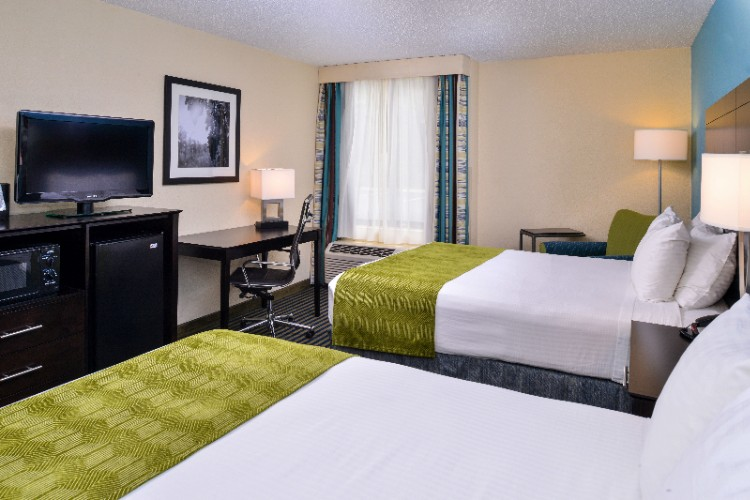 Our Professionally Decorated Rooms Were Renovated In 2016 And Are Designed With Your Comfort In Mind Including Comfortable Beds A Sitting Area And Large Desk. 5 of 14
