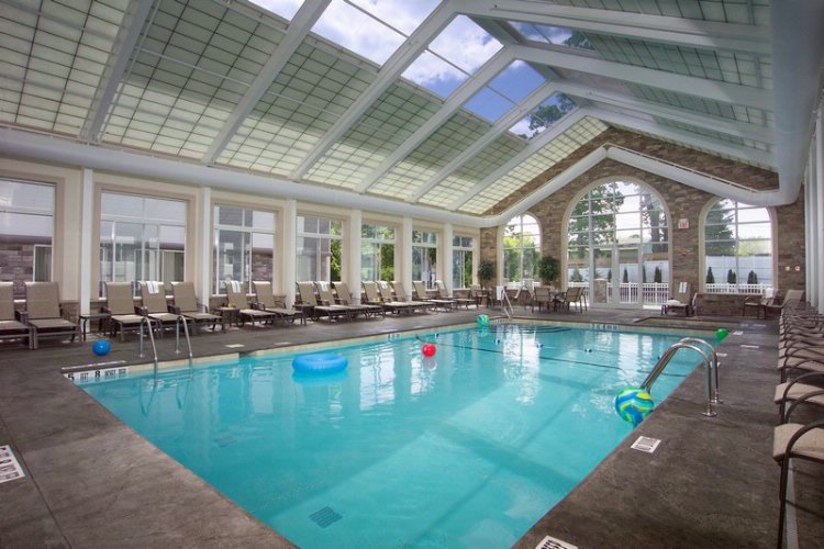 Heated Indoor Pool With Solarium Styled Roof 11 of 12