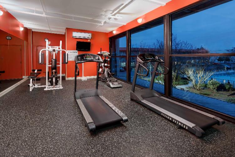 24/7 Fitness Center -Featuring Treadmills Stationary Bike Weight Machine Elliptical & Free Weights 10 of 11