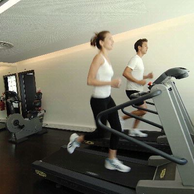 Fitness Couple Running On Home Trainer At Intercontinental Geneve 21 of 31