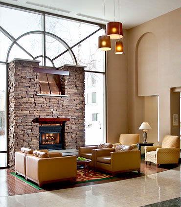 Lounge By Our Cozy Lobby Fireplace 4 of 11