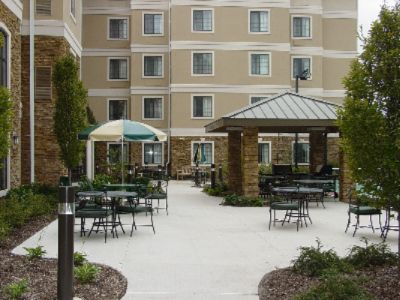 Enjoy The Outdoors In Our Beautiful Courtyard. You Can Bar-B Q On Our Gas Grills Or Play A Game Of Tennis Basketball Volleyball Or Badmitten With Friends. 10 of 11