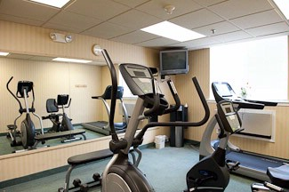 24-Hr Fitness Room With Tv And Water Cooler 5 of 12