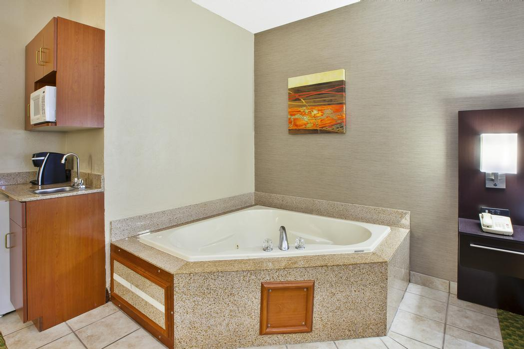 Jacuzzi Suite With King Bed Tub View 11 of 15