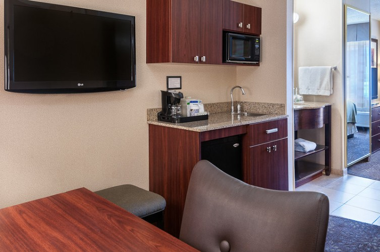 Kitchenette Area With Desktv And Relaxing Chair 5 of 12