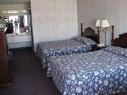 Amazinn & Suites Queen Bed Room 7 of 9