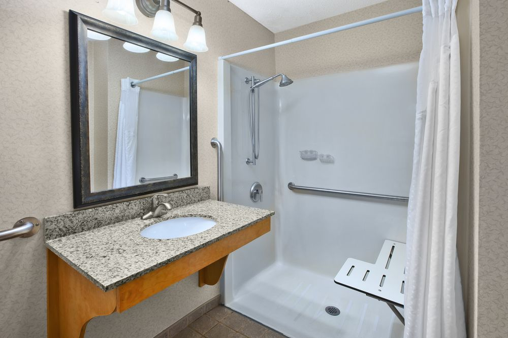 Queen Bed Room With Accessible Roll In Shower Bathroom 19 of 32