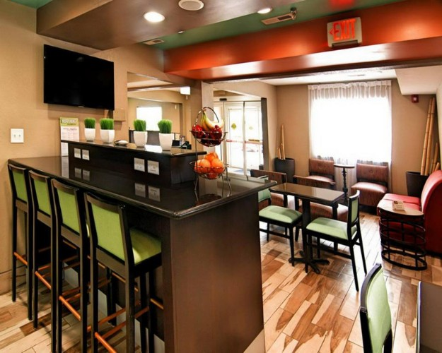 Electric Sockets And Usb Connections Make The Community Bar A Great Place To Sit With Your Lap Top! 17 of 24
