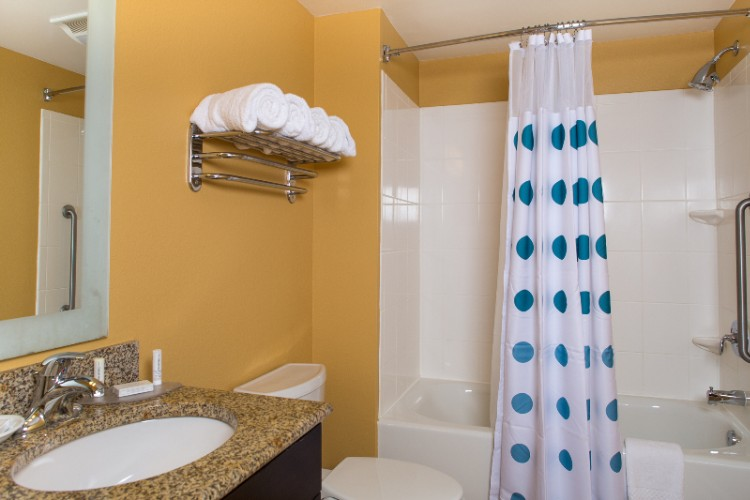Our Large Guest Bathrooms Are Perfect To Accommodate Any Traveler With Spacious Granite Countertops Curved Shower Rod And Deluxe Bathroom Soaps And Shampoos. 9 of 9