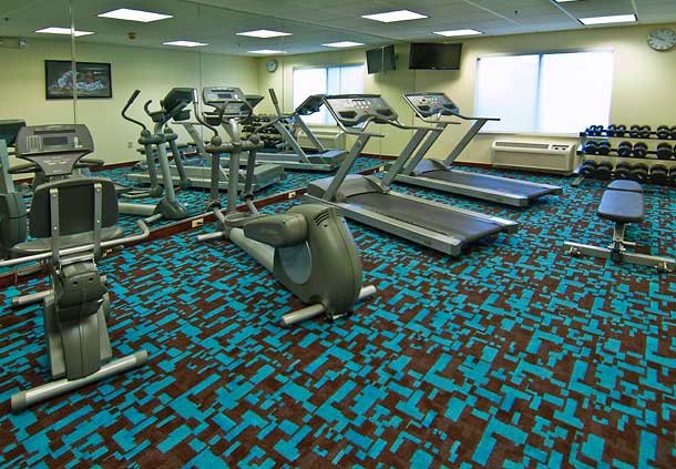 Our 24-Hour Fitness Center Has Extensive Cardio Equipment As Well As Free Weights. 12 of 17