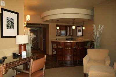 The Presidential Suite Includes A Full Bar And Kitchenette. 6 of 11
