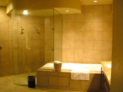 Some Suites Have Unique Stone-And-Glass Showers Or Jetted Tubs. 8 of 11