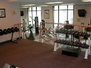 Fitness Room With 7 Cardio Machines And Free Weights 9 of 11