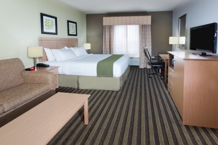 Our Richly Appointed Spacious Guest Room With A King Bed And Sofa Sleeper. 11 of 15