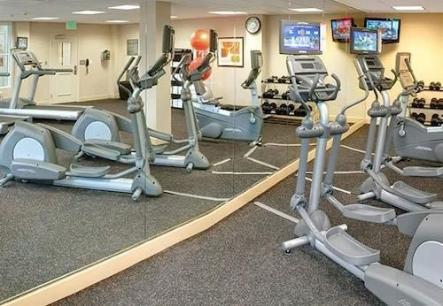 Recharge In Our Fitness Center Featuring Modern Equipment And Weights. 14 of 16