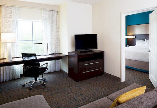 Our Spacious One-Bedroom Suites Feature A Bedroom And Bathroom Separated By A Door Plus A Living Room Desk And Full Kitchen. 7 of 16