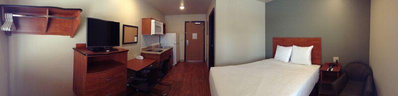 Woodspring Suites Single Room 3 of 9