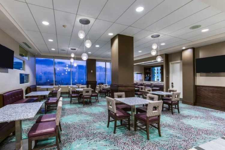 Our Hotel Offers Contemporary Dining Seating That Overflows Into The Hotel Lobby Bar And Grille With Flat-Panel Tv\'s. 11 of 13