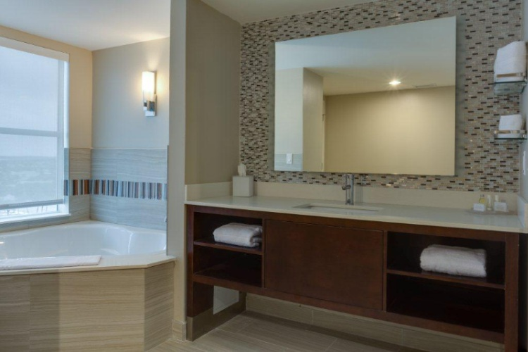 Our Suite Bathroom Featuring A Jetted Garden Tub And A Separate Glass Enclosed Walk-In Shower With Separate Vanity Area. 12 of 13