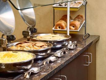 Hot Breakfast Buffet With 4-5 Different Fresh Fruits And Melon Protein From Eggs And Specialty Items As Well As Carbs From Pastries Bagels Cereals Bon Apetite! 9 of 11