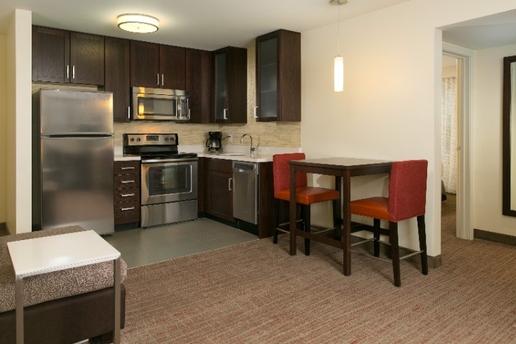 Our One-Bedroom Suites Include A Fully Equipped Kitchen And Dining Table. 13 of 19