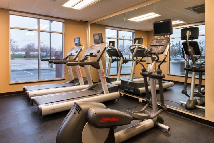 Start The Day Out Right With Our Fitness Center Complete With Machines And Free Weights 9 of 16